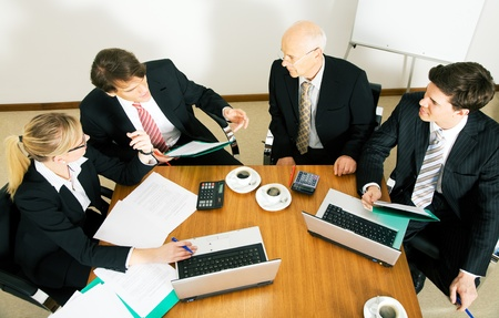 proposals: Businesspeople crunching the numbers of a business plan Stock Photo