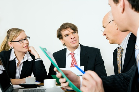 Four businesspeople in a meeting  photo