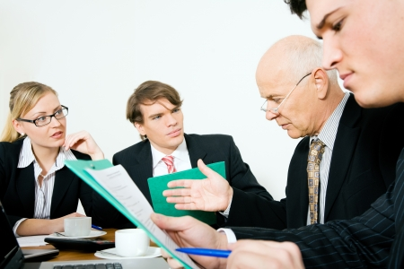 decision making: Senior Team leader making a decision. Period! (focus only on the senior man!) Stock Photo