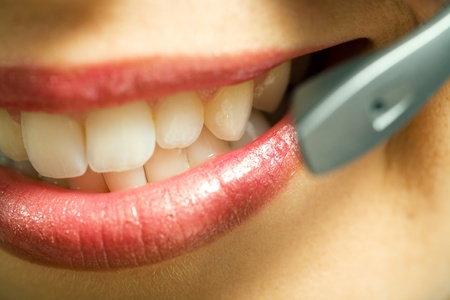 Close-up (mouth) of a friendly female call center operator; very shallow depth of field Stock Photo - 10305941