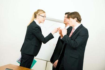 argumento: Empresaria criticando su colega Foto de archivo