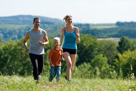 Active Family jogging outdoors in beautiful summer landscape   photo