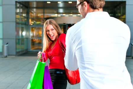 Woman wants to shop into mall, dragging her man or boyfriend to join   photo