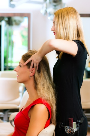 hair stylist: Woman at the hairdresser getting a head massage in the salon