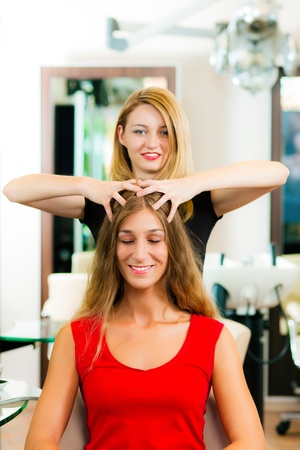 Woman at the hairdresser getting a head massage in the salon   Stock Photo - 10428051