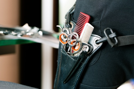 hair stylist: Closeup of Scissor bag or holster of hairdresser worn around the hip with lots of tools