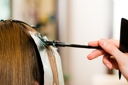 At the hairdresser woman gets new hair colour, close-up on strand of hair Stock Photo - 10428411