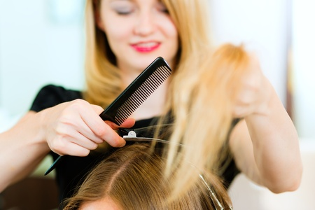 Woman at the hairdresser, she is cutting - close-up with selective focus on her hands   Stock Photo - 10428048