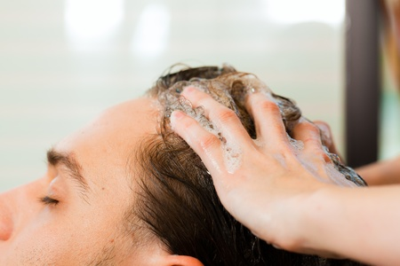 Man at the hairdresser getting his hair washed and rinsed feeling visibly well Stock Photo - 10428054