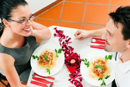 Couple at lunch or dinner; very romantic setting photo