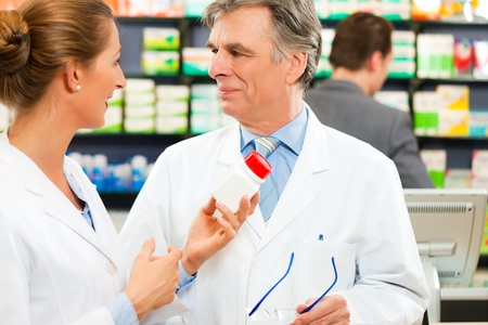 health professionals: Two pharmacists in pharmacy consulting