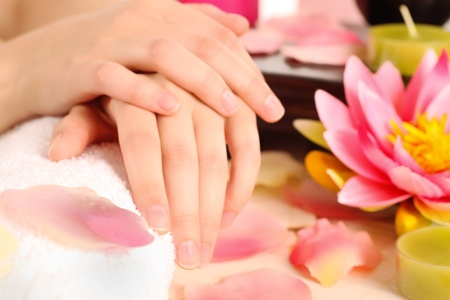 manicurist: Woman with beautiful hands after a manicure Stock Photo