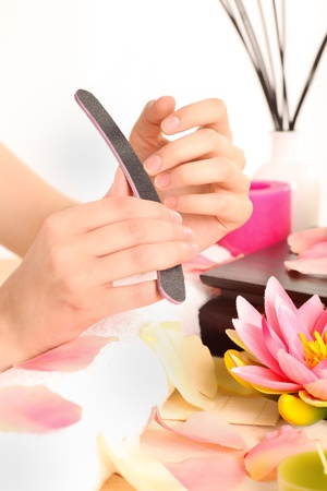 manicurist: Woman takes care about her nails - manicure   Stock Photo