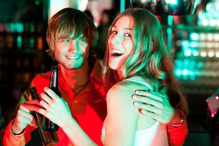 Couple having drinks in a bar or nightclub   photo