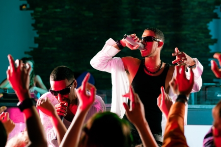 Rap or Hip-Hop Musicians performing on stage in a club in front of a cheering crowd Stock Photo - 10448763