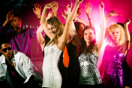 nightclub crowd: Dance action in a disco club - group of friends, men and women of different ethnicity, dancing to the music having lots of fun