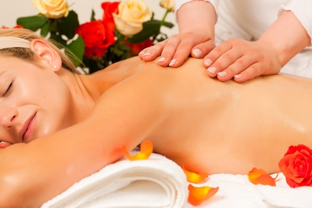 Woman enjoying a wellness back massage in a spa, she is very relaxed (close-up)   photo