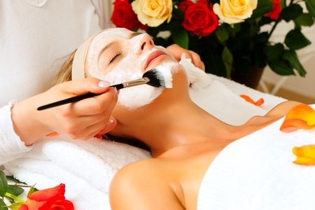 Woman having a mask or cream applied in the course of a beauty or wellness treatment