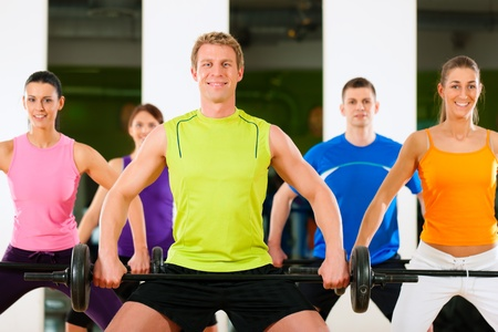 Group of five people exercising using barbells in gym or fitness club to gain strength and fitness Stock Photo - 10448795