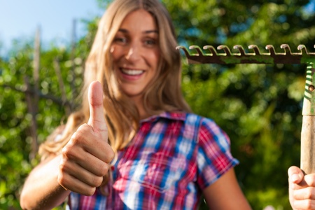 thumps up: Gardening in summer - happy woman grate, thumps up!