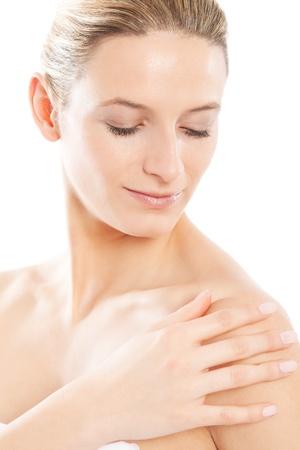 free radicals: Beautiful woman run her hand over her soft skin Stock Photo