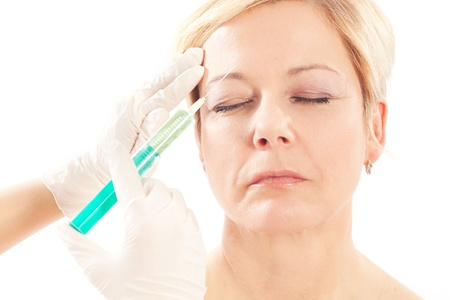 fillers: Botox - Age and beauty; a doctor is doing the injection Stock Photo