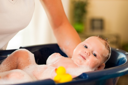 baby bath: Mother is bathing her baby (just hands) Stock Photo