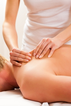 physiotherapist: Patient at the physiotherapy gets massage or lymphatic drainage Stock Photo
