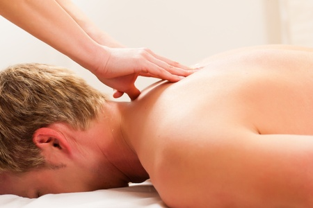 Massage therapy: Patient at the physiotherapy gets massage or lymphatic drainage Stock Photo