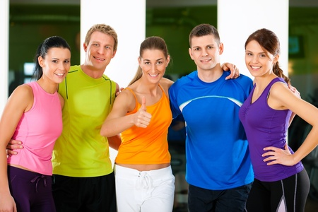 Group of five people exercising in gym or fitness club  Stock Photo - 10718095