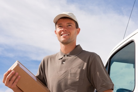 mail man: Postal service - delivery of a package through a delivery service Stock Photo