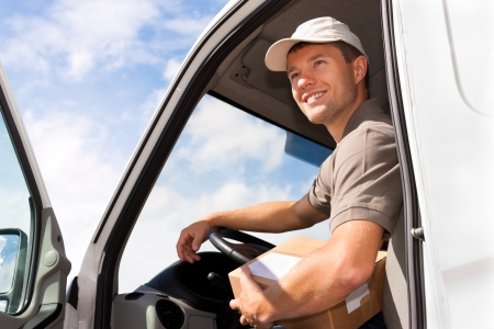 delivery package: Postal service - delivery of a package through a delivery service Stock Photo