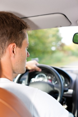 test drive: Driver is sitting in his car or van and is driving