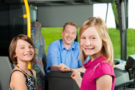 traffic ticket: Children boarding a bus and buying a ticket