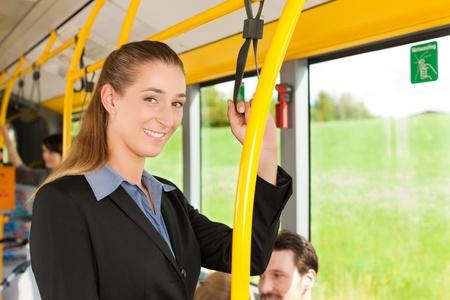 passenger: Female passenger in a bus; presumably she is heading home