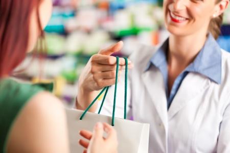 pharmacy: Female pharmacist with a female customer in her pharmacy