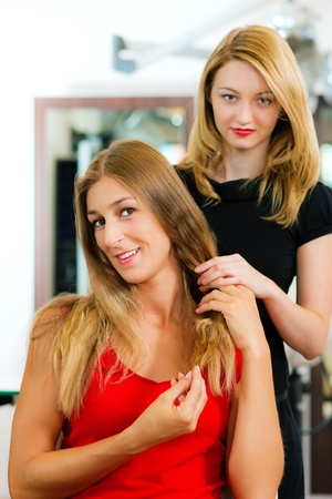 advise: Woman at the hairdresser getting advise on her hair styling