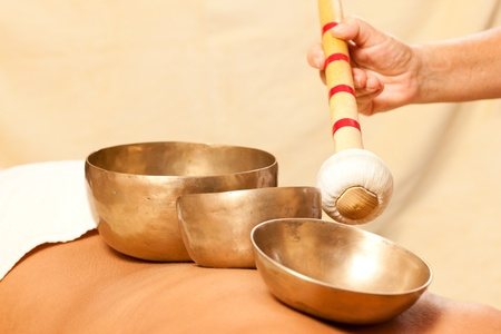 Woman in wellness and spa setting having a singing bowl therapy session Stock Photo - 10769908