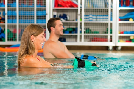 Couple exercising Aquarobics or hydrotherapy in spa  photo