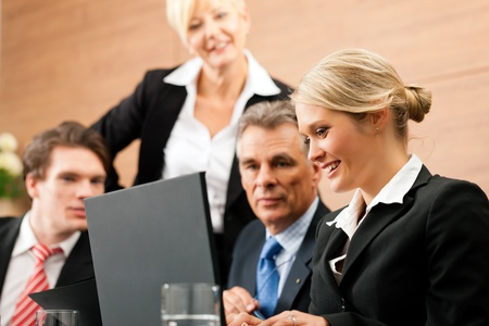 Business - team meeting in an office with laptop, the boss with his employees Stock Photo - 10965389