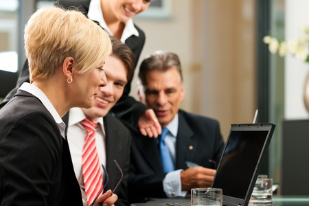 Business - team meeting in an office with laptop, the boss with his employees Stock Photo - 10965266