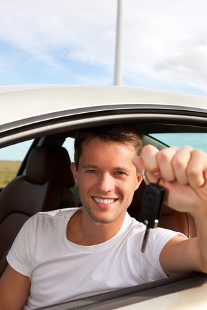 instructor: Man is holding his car key sitting himself in the automobile and obviously has fun
