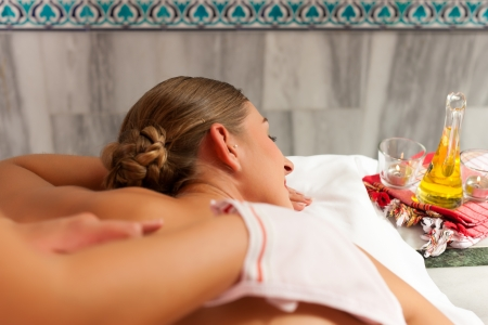 body massage: Wellness - woman getting massage in Spa; the therapist is using a glove Stock Photo