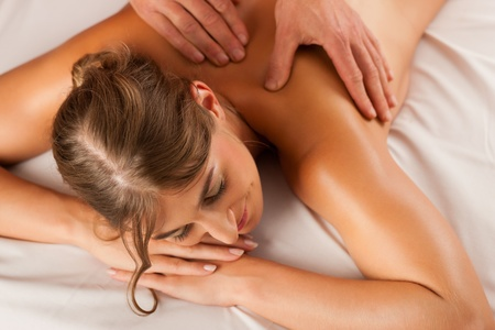 back massage: Woman enjoying a wellness back massage in a spa, she is very relaxed (close-up) Stock Photo