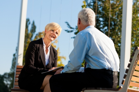 sessions: Coaching outdoors - a man and a woman have a coaching discussion