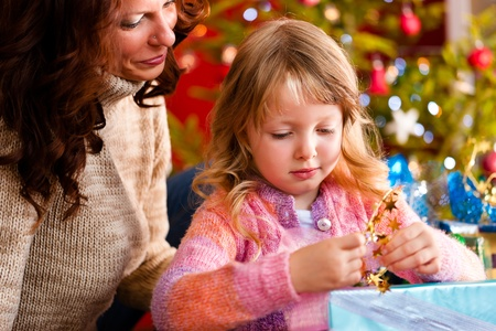 Christmas - happy family (mother with daughter) with gifts on Xmas Eve Stock Photo - 10965330