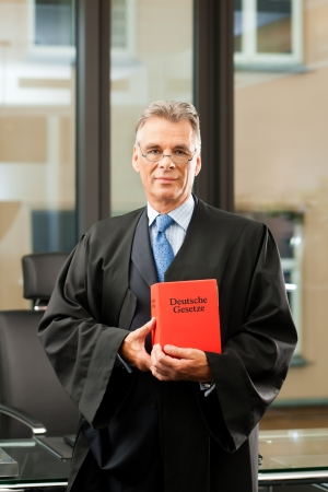 civil law: Lawyer with civil law code in a court room