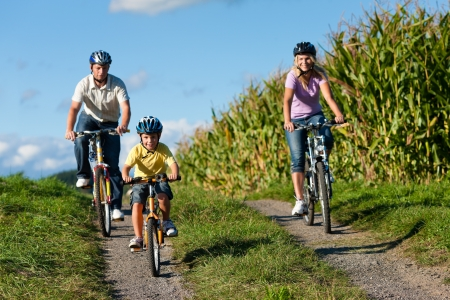 Family is cycling in summer - here mother, father and son Stock Photo - 11193711
