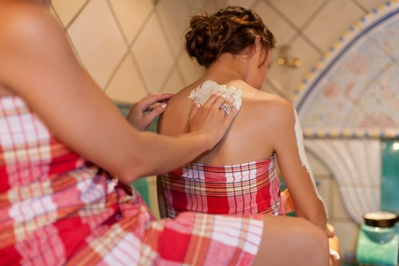 turkish people: Two female friends doing wellness in the sauna of a thermal bath