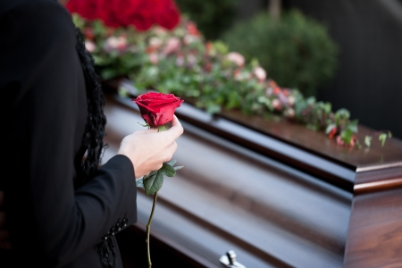 mourn: Religion, death and dolor  - funeral and cemetery; funeral with coffin Stock Photo